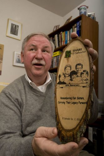 Tom Howarth holds a momento from his memorial trip to El Salvador for the 35th anniversary of the deaths of four murdered churchwomen in 1980.  Rich Cooley/Daily